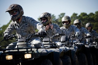 Air Force personnel on ATVs