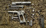 Disassembled 1911 pistol