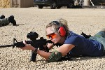 girl shooting rifle from prone position
