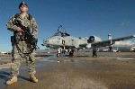AIr Force security policeman guards A 10 Warthog