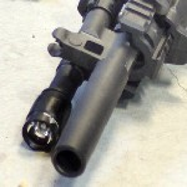 travis gun muzzle device